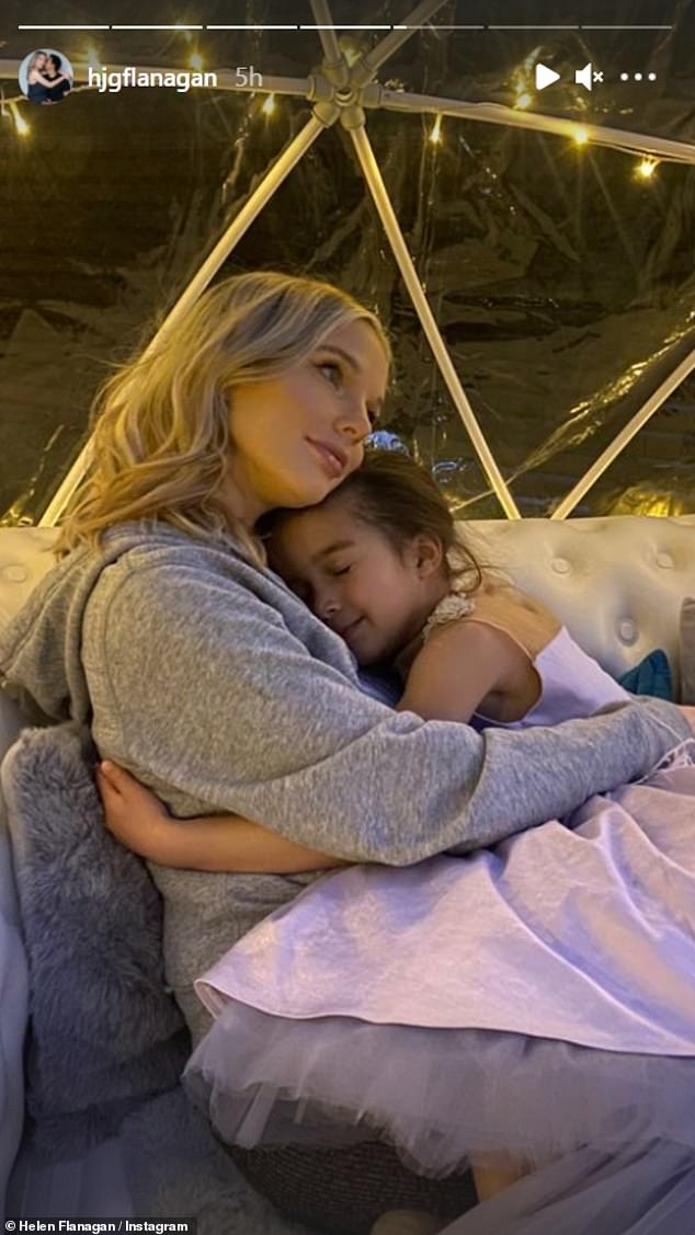 Mother daughter time: The mother-of-three bundled up in a grey hoodie while Matilda wrapped her arms around Helen and closed her eyes