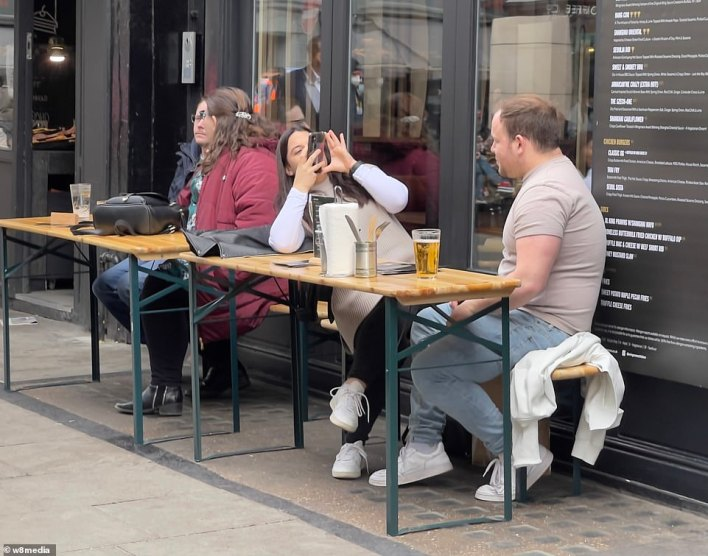 People enjoying a late lunch in Soho this afternoon as London's West End welcomes people back this week