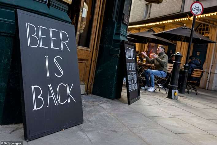 """A sign outside a pub near Covent Garden which reads """"BEER IS BACK"""" ahead of what is expected to be a busy night"""