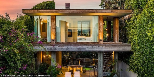 Fun look:The property is roomy with four bedrooms and four-and-a-half bathrooms in what looks like a very modern tree house. The unusual structure was designed by architect Philip Vertoch