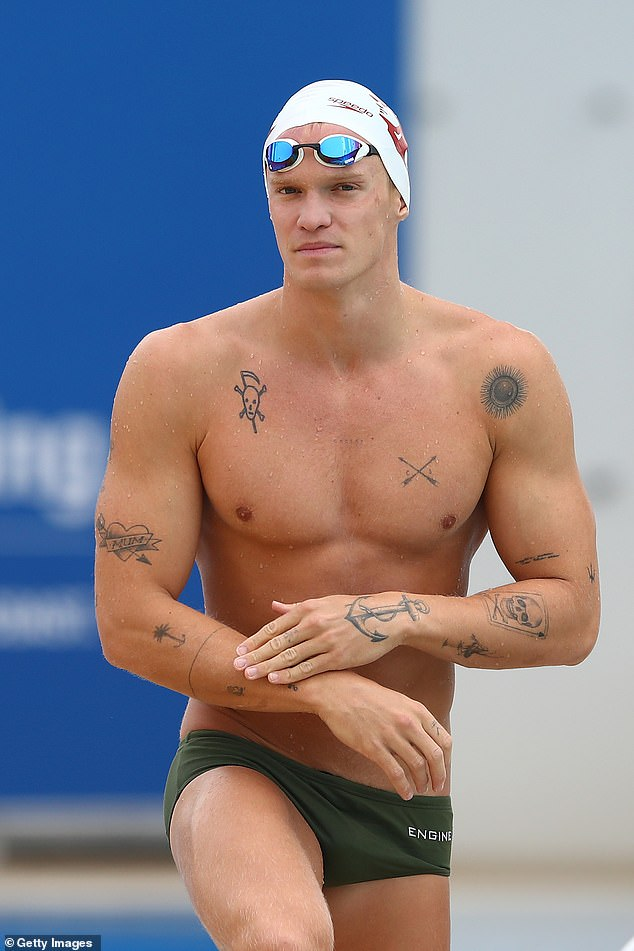 Giving it a go! Cody Simpson (pictured), 24, turned heads on Saturday when he got ready to swim the 50m butterfly race in the Australian National Championships at Southport on Queensland's Gold Coast