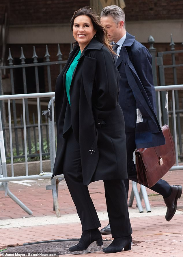Layering: The actress wore a full-size black overcoat and a set of matching pants and shoes while filming an episode of the show's upcoming season