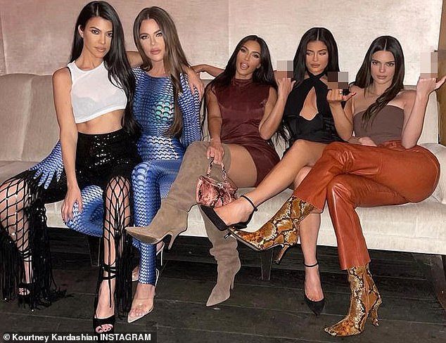 Meanwhile: Kim Kardashian slipped into a maroon mini-dress that showed off her knockout legs which she emphasized with stiletto boots