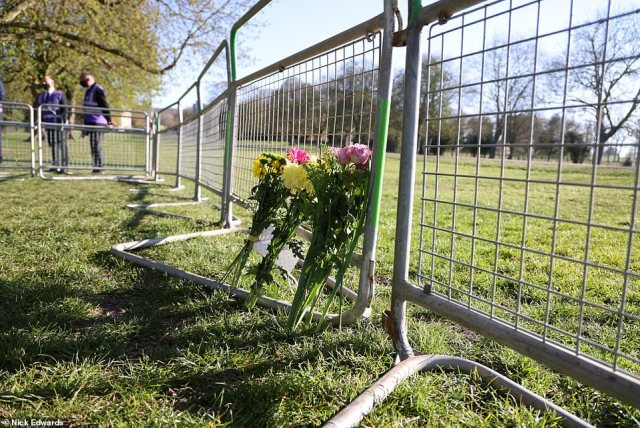 Flowers are laid by well-wishers early this morning