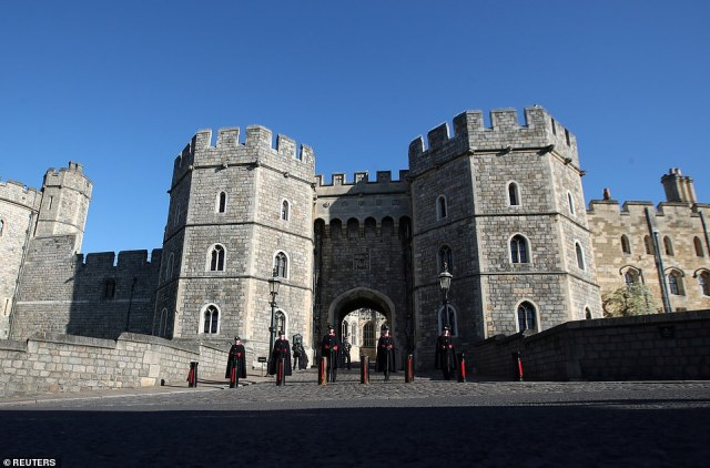 Wardens stand outside Windsor Castle on the day of the funeral of Britain's Prince Philip