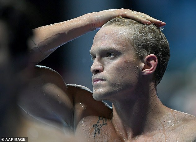 Not happy: The 24-year-old's disappointment was written on his face after leaving the pool after the race