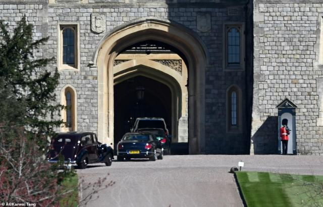 The first mourners have been swept into Windsor Castle as Prince Philip's coffin is moved into position ahead of his funeral this afternoon