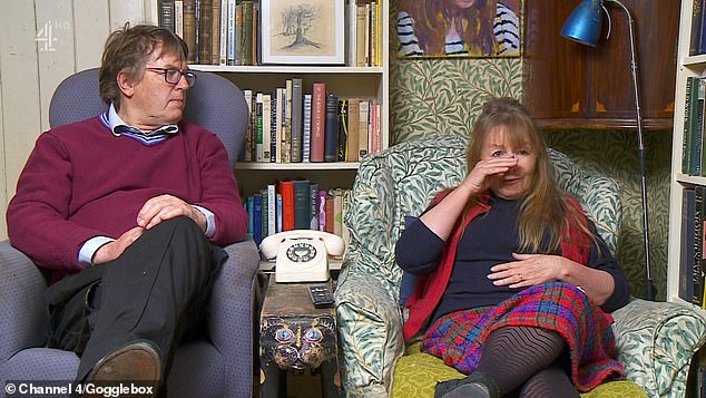 Upset: Meanwhile, Mary, 68, was consoled by her husband Charles as she spoke about the Queen