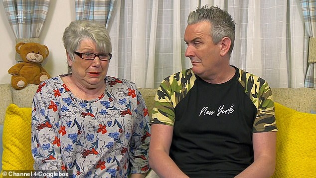 Teary: Jenny, 65, sobbed as she watched bulletin before her friend Lee Riley, 51, comforted her by joking he 'I'll let you off this time, you can cry'