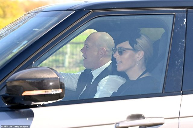 Mike Tindall and Zara Phillips, who recently had a baby named after the Duke of Edinburgh, drive into the castle this afternoon