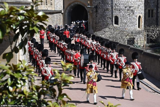 The Foot Guards Band are seen marching as the world remembers the extraordinary 99-year life of Philip