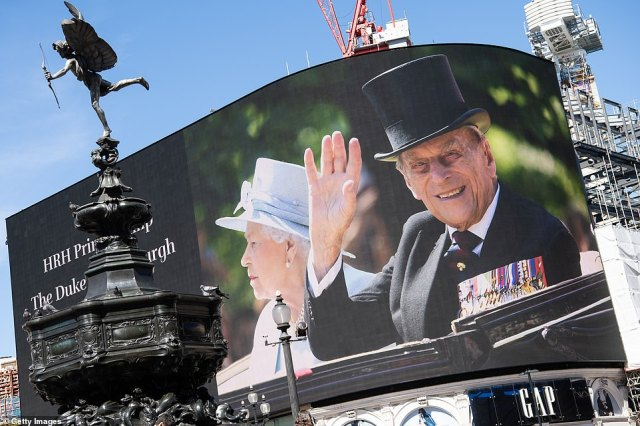 Photos of Prince Philip displayed on a large screen at Piccadilly Circus this afternoon ahead of the Duke of Edinburgh's funeral