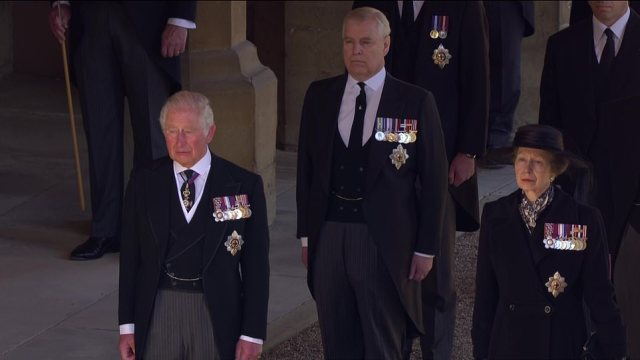 Prince Charles looks emotional as he is joined by Prince Andrew and Princess Anne as they follow their father's coffin