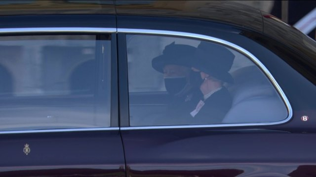 The Queen, accompanied by a lady-in-waiting,left from the Sovereign's Entrance in the State Bentley and followed behind her husband's coffin