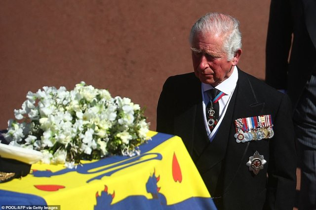 Prince Charles looked grief stricken as he followed his father on the final journey to church
