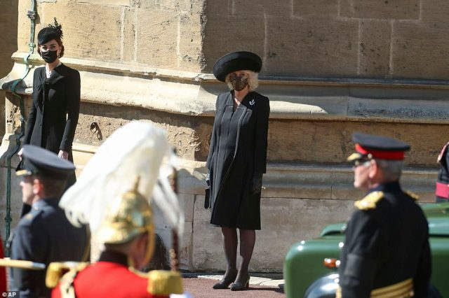 The 39-year-old stood outside St George's Chapel beside the Duchess of Cornwall