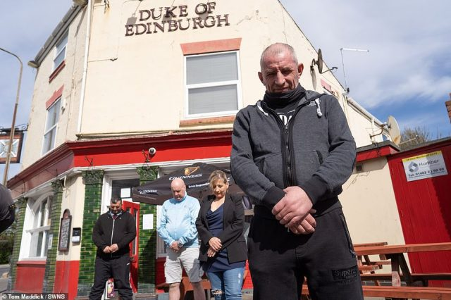 Drinkers at the Duke of Edinburgh pub in Hull observe a minute's silence during the funeral of the Duke of Edinburgh at Windsor castle
