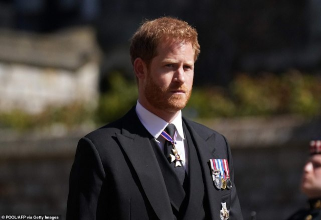 Prince Harry, Duke of Sussex walks during the funeral procession of Britain's Prince Philip this afternoon after flying in from LA for the event