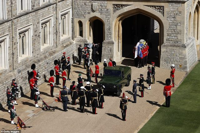 The bearer Party found by The Queen's Company, 1st Battalion Grenadier Guards carry the coffin of HRH Prince Philip, Duke of Edinburgh to the purpose built Land Rover Hearse