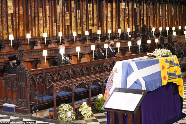 Queen Elizabeth II looks at the coffin of Prince Philip as she began life without him aged 94
