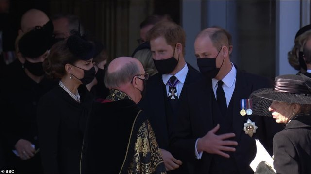 Prince Harry and Prince William walk next to each other as they leave the funeral service at St George's Chapel this afternoon