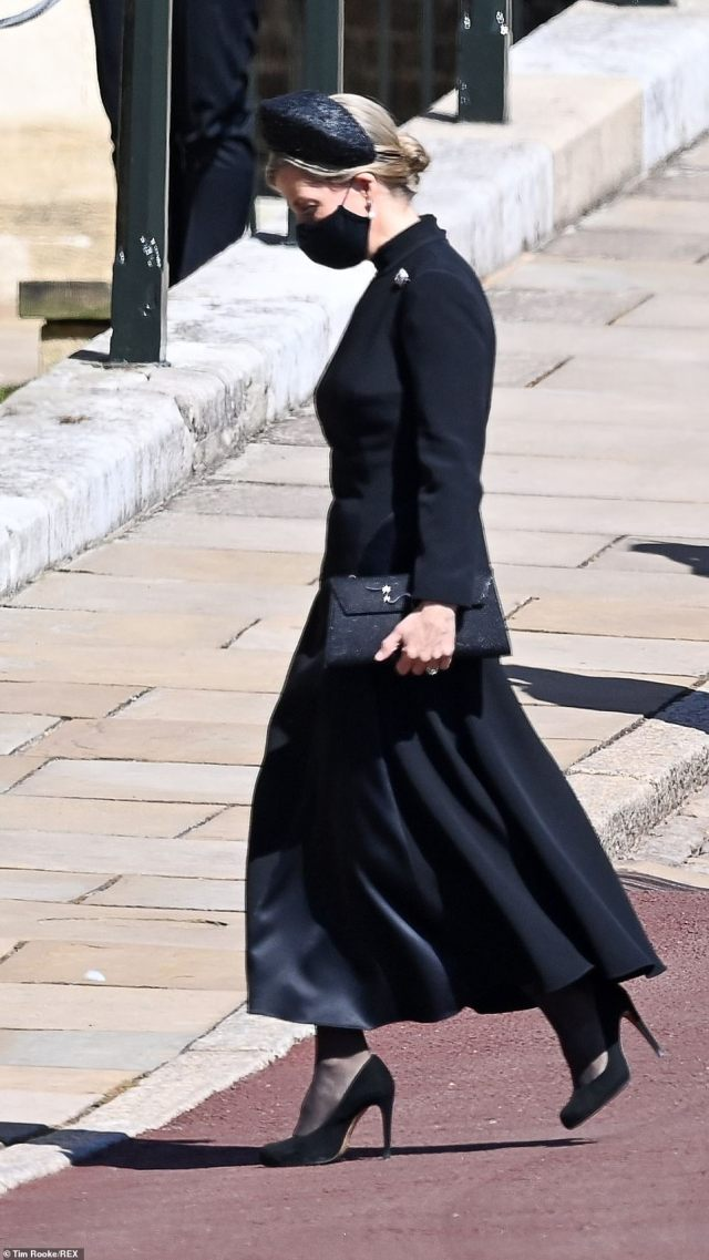 Looking equally elegant, Sophie, Countess of Wessex, sported an ankle-length black dress coat and sling-back heels to enter the chapel