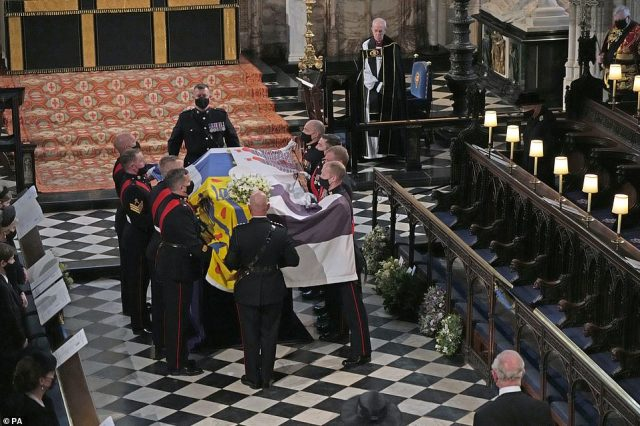 Queen Elizabeth II (top right) and the Archbishop of Canterbury Justin Welby watch as the Duke of Edinburgh's coffin is placed