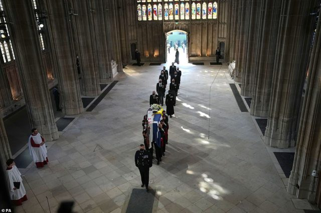 Pall Bearers carrying the coffin of the Duke of Edinburgh enter St George's Chapel followed by members of the royal family