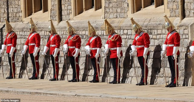 Members of the Household Cavalry lined the route of the ceremonial procession and lowered their heads as the coffin passed them