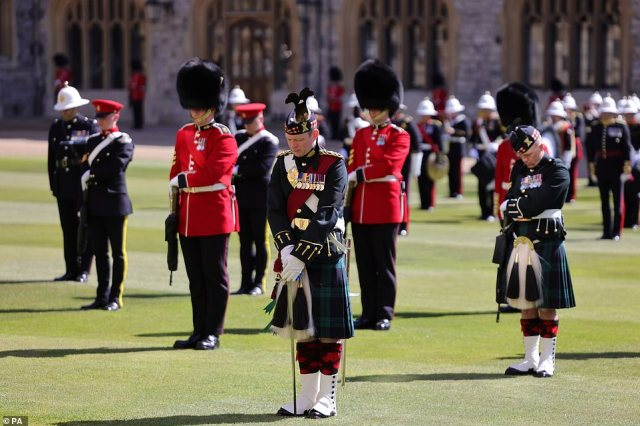 Members of the military stand for a minutes' silence before the funeral of the Duke of Edinburgh