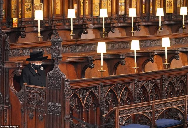 Her Majesty then put on her spectacles as she sat alone and looked towards the altar during the poignant service