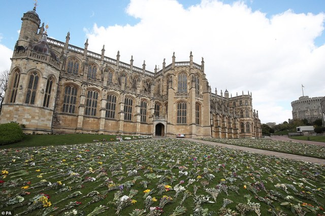 Flowers outside St George's Chapel, at Windsor Castle, Berkshire, following the death of the Duke of Edinburgh at the age of 99