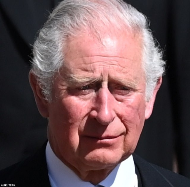 A tear rolled down Prince Charles' cheek as he walked behind his father Prince Philip's coffin at Windsor Castle