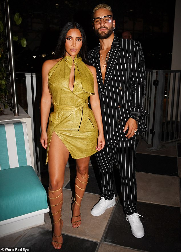 Fellow celebs: The founder of KKW Beauty took the time to pose with celebrities such as singer Maluma, 27.  Leaving her luxurious locks dark, she could be seen balancing on a pair of dizzying stilettos with straps twisting almost to the knee.