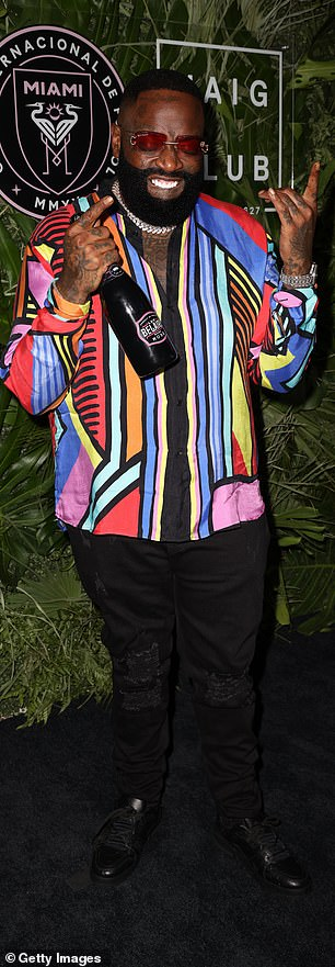 Big boss: Rick Ross opted for a multi-colored button-down shirt and black jeans for the event