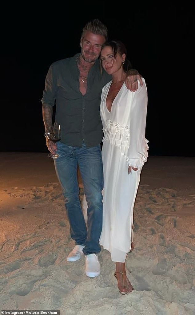Loved-up:The former artist updated fans on her special occasion on social media, with her spouse David enthusing she deserved the 'best day ever' (pictured on the beach on Saturday)