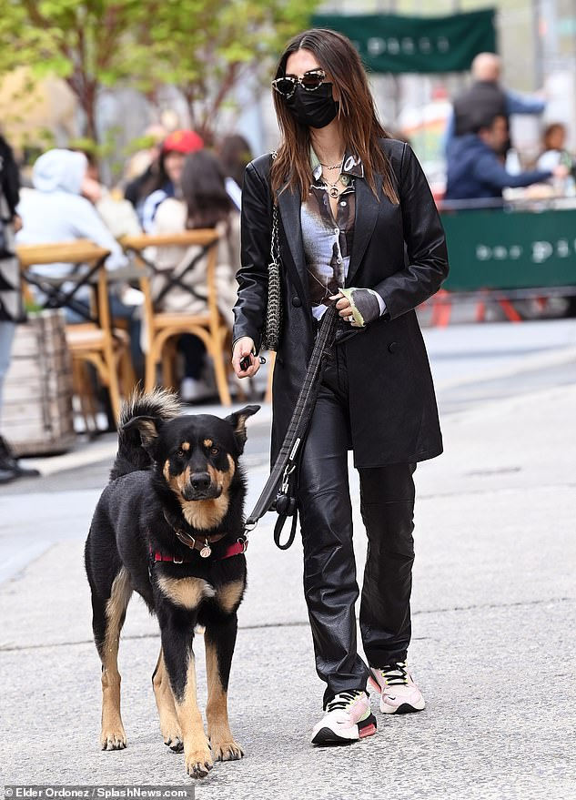Puppy love: London-born cutie raised in California takes beloved dog Colombo away from outdoor dining area after meal