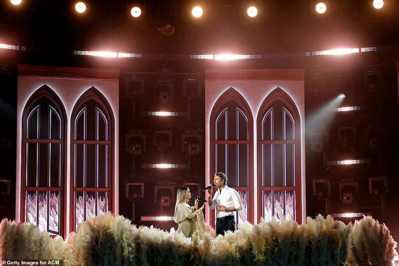 Take it to church: They were on a set designed like a church set with tall arched wi