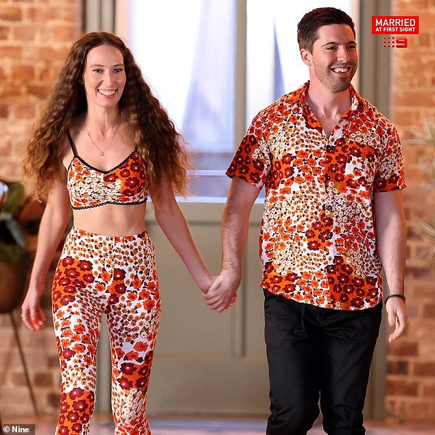Perfect match: For the show's final dinner party, Belinda stepped out in a pair of orange, maroon, white and yellow floral print flares, which she teamed with a matching crop top