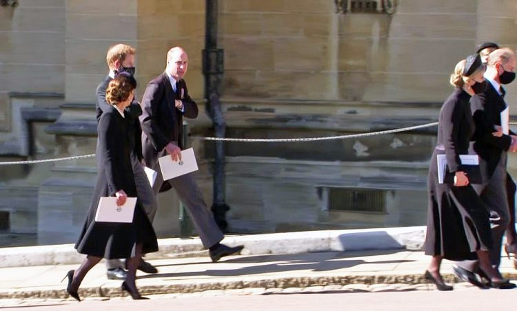 Kate Middleton, Prince Harry and Prince William are seen talking as they walk away fromSt George's Chapel after Prince Philip's funeral service