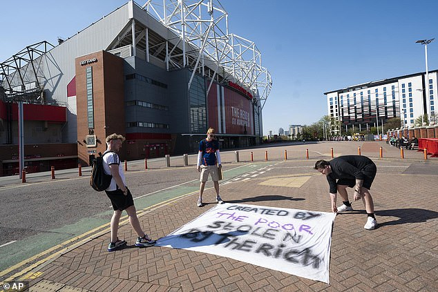 Manchester United fans also laid protest banners outside Old Trafford in response to the move