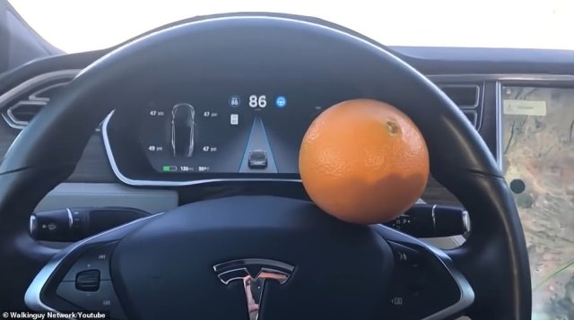 Tesla will stop driving on autopilot if it cannot detect a person's hands on the wheel. To get around it, people have been doing this - putting an item on the wheel or lodging it there - to trick it