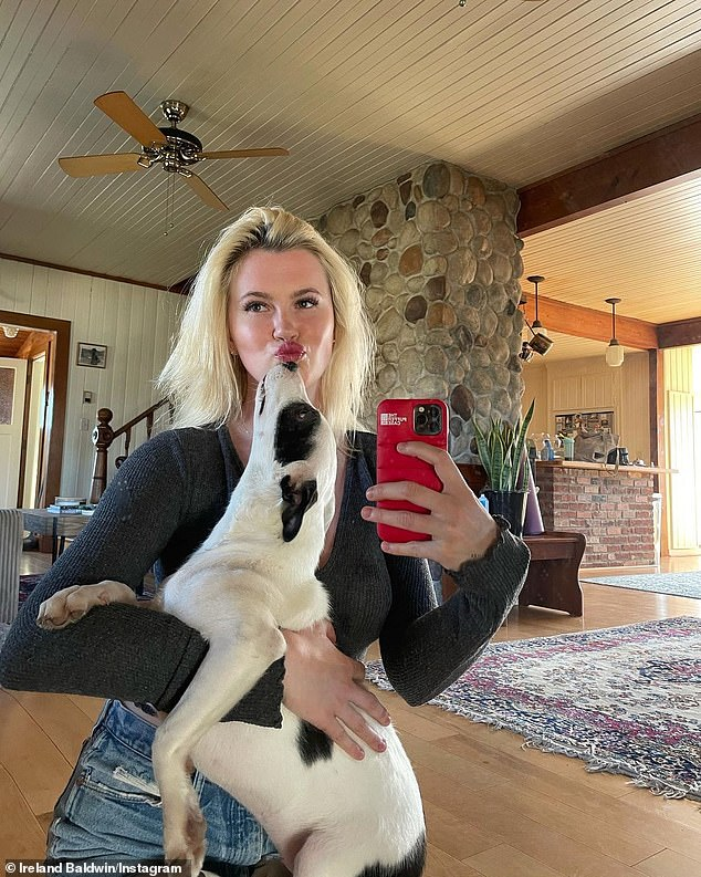 Latest addition to the family: She's also recently added another fur baby to her family. She posed holding her newest rescue pup in her arms for a mirror selfie
