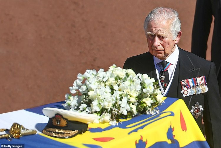 Prince Charles walks behind the Duke of Edinburgh's coffin at it makes its way to St George's Chapel in Windsor
