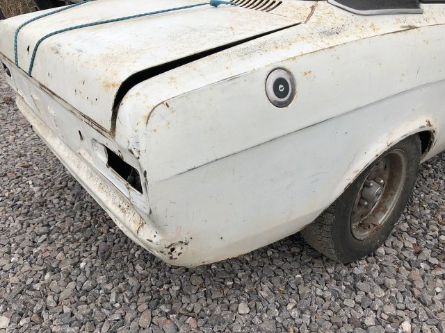 The car's bodywork is rusty and pockmarked. Its rear lights are also missing. Whoever buys it will need to spend a hefty sum restoring it