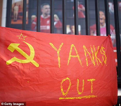 Banners and football scarves are tied to the fences around Anfield Stadium, the home of Liverpool Football Club, before the American owner issued a humbling apology