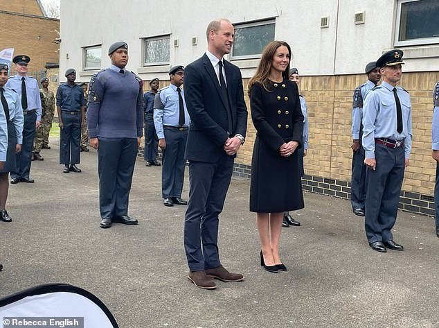 Special visit:Kate, 39, donned the black coat with gold button detailing as she joined husband Prince William on a tour of the 282 East Ham Squadron Air Training Corps