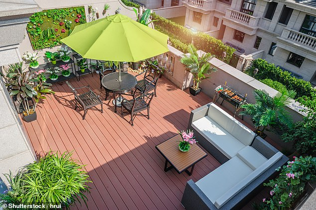 Using every part of your balcony space, including the walls can make you feel surrounded by greenery