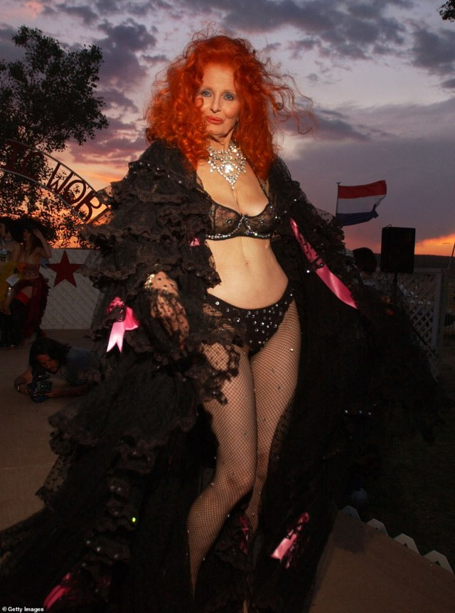 Sexy at 75! Storm is seen at the 2003 Miss Exotic World Pageant putting her incredible body on show in lacy lingerie