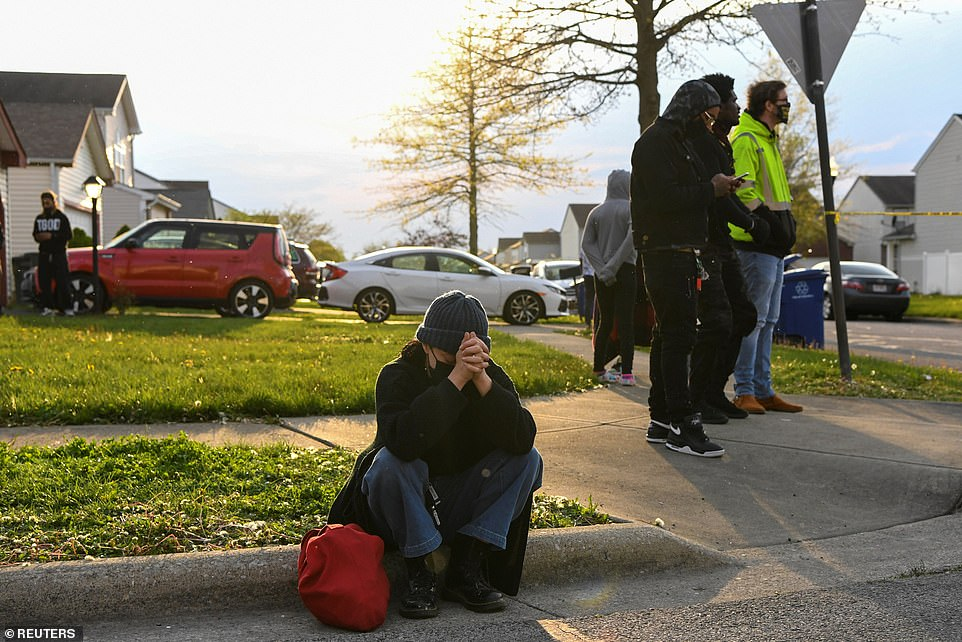 A woman reacts to the shooting in Columbus